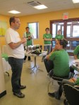 Milford Branch Director Chad Robinson welcomes Starbucks volunteers