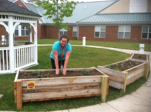 Christina Moore, activities therapist, shows off the new beds at the Delaware Veterans Home.