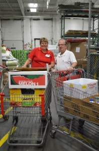 Ed Maynard (left) of Cedars Church of Christ poses with a BJ's Wholesale Club employee at the Newark store. Cedars picks up from BJ's stores on a weekly basis and will benefit from BJ's generous donation.